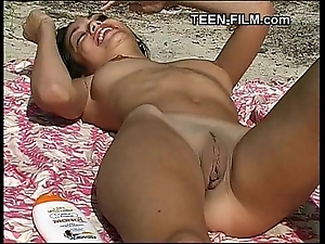Eighteen time venerable nudist legal age teenager at one's disposal seashore