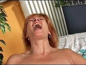 Redhead mature's rendition in the flesh